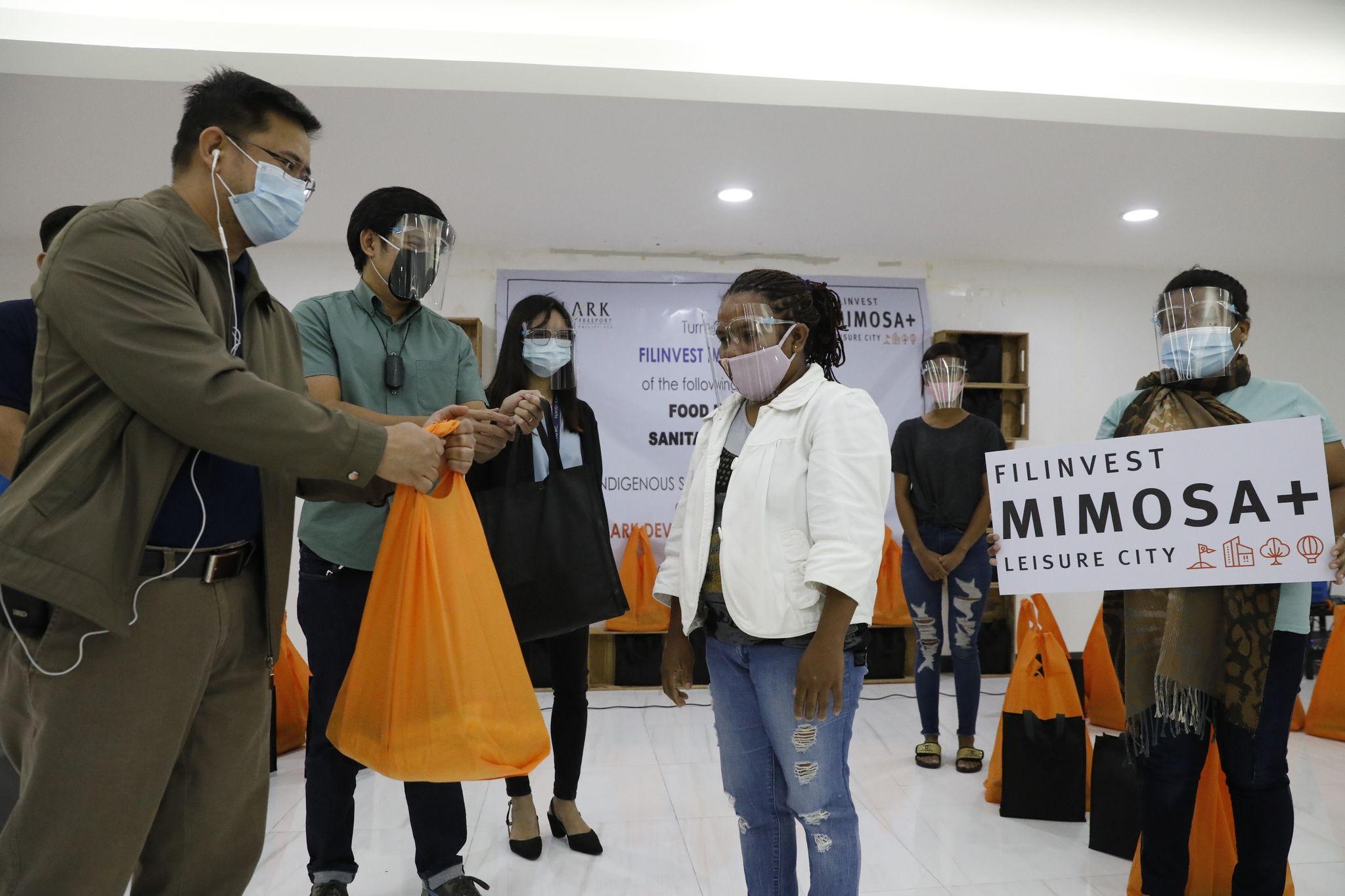 Clark locator donates assorted goods to 18 Aeta 'soap smiths'